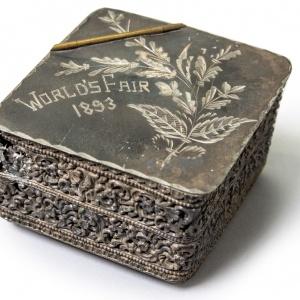Metal box documenting a World's Fair, circa 1893